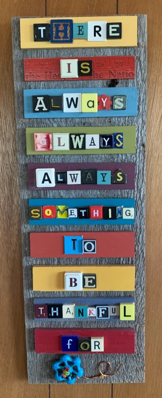 "The author's mom's sign uses board game tiles to spell out the message ""There is always, always, always something to be thankful for"""