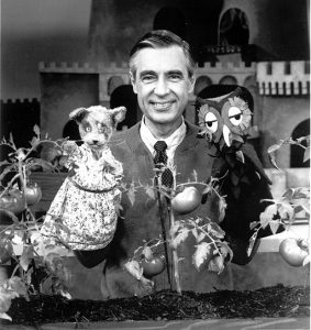 Fred Rogers on the set of Mr. Rogers' Neighborhood with puppets Henrietta Pussycat and X the Owl